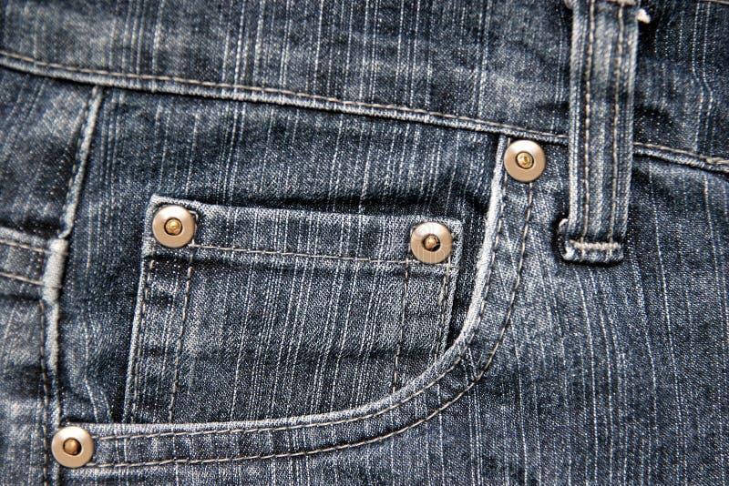 Jeans stoppa i fickan royaltyfri foto