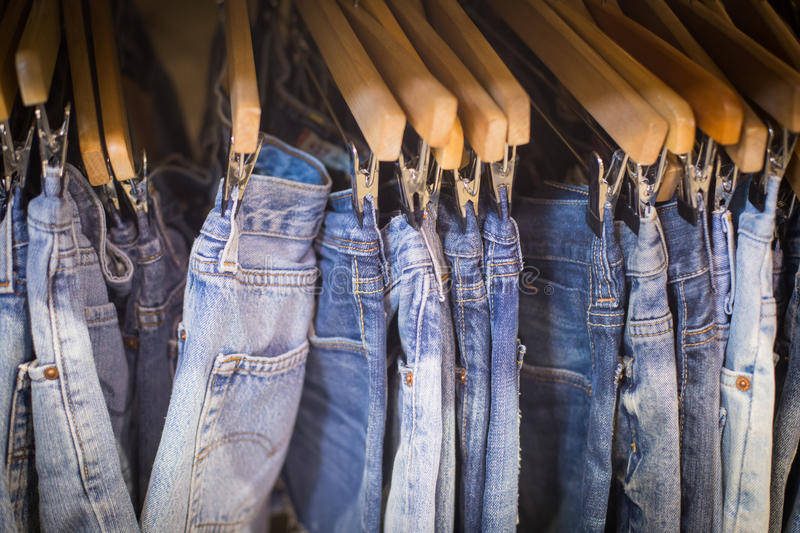 Jeans in the store. Jeans hanging in the retail store royalty free stock image