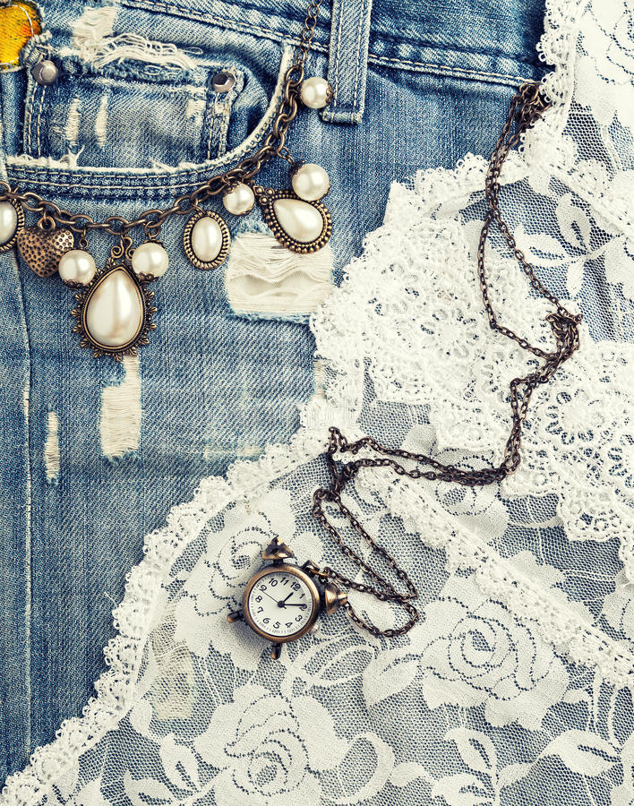 Jeans texture. Retro background with vintage jewelry and jeans texture royalty free stock photo