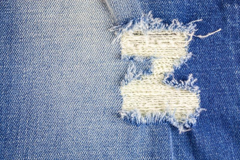 Jeans torn denim texture. Abstract, apparel, backdrop, background, blank, blue, border, canvas, casual, closeup, cloth, clothes, clothing, cotton, country stock photos