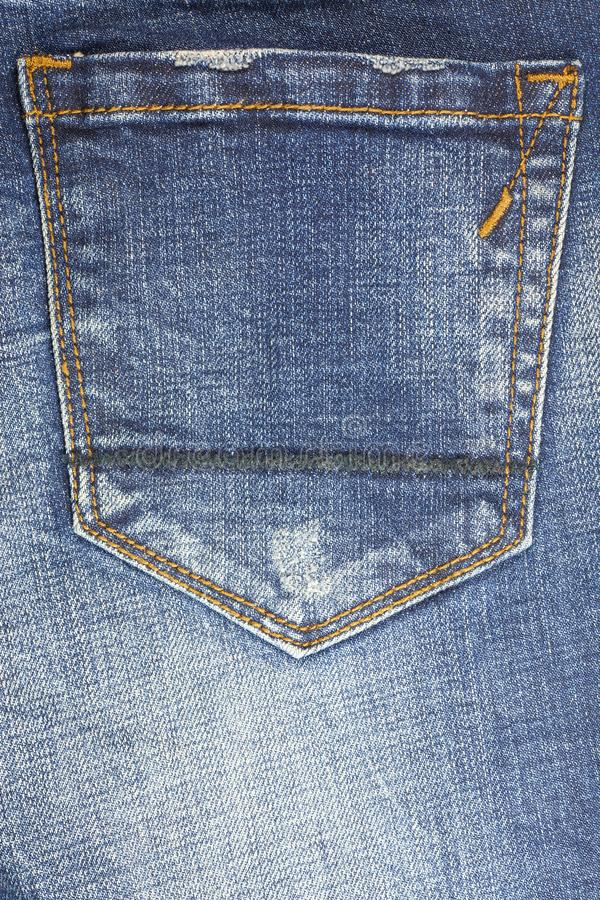 Jeans torn denim texture background. Abstract, aged, apparel, blank, blue, canvas, casual, closeup, cloth, clothes, clothing, color, cotton, country, design stock photo