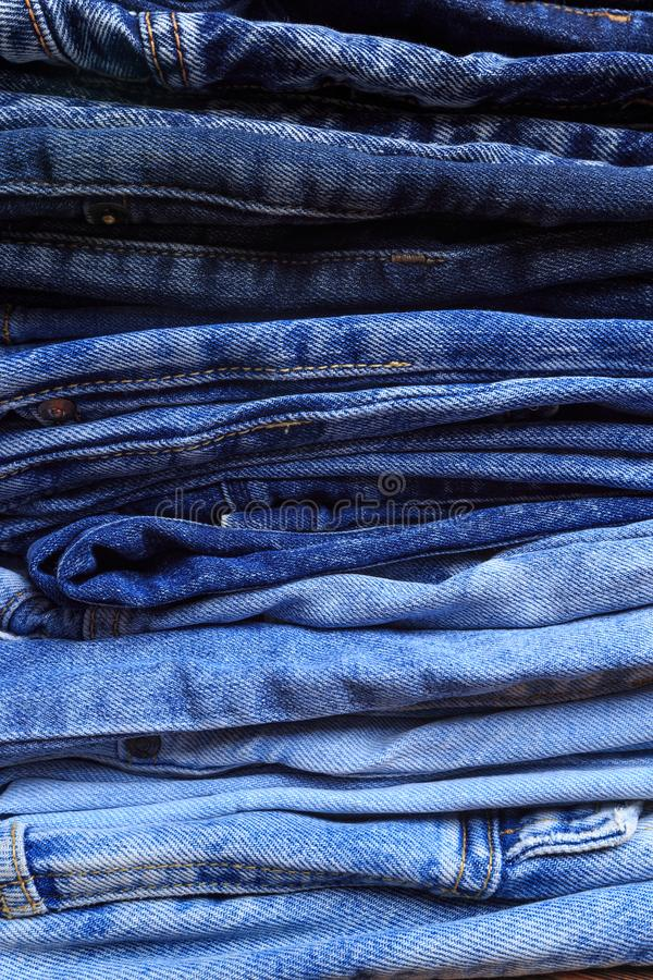 Jeans trousers stack closeup background texture - Image. Jeans trousers stack closeup background texture royalty free stock photos