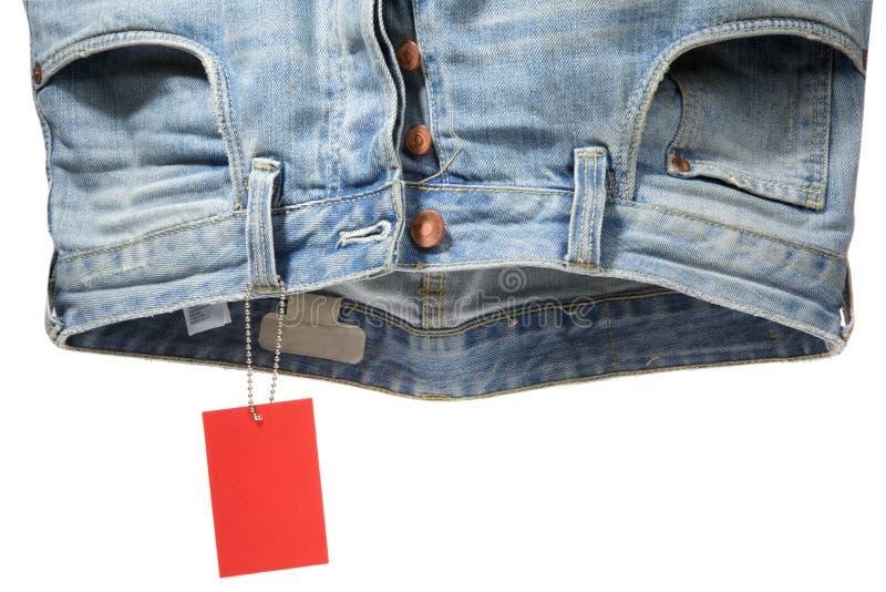 Jeans und Kennsatz lizenzfreie stockbilder