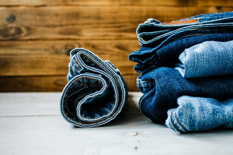 Jeans on a wooden background royalty free stock images