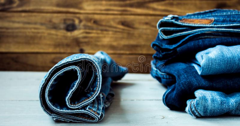 Jeans on a wooden background stock images