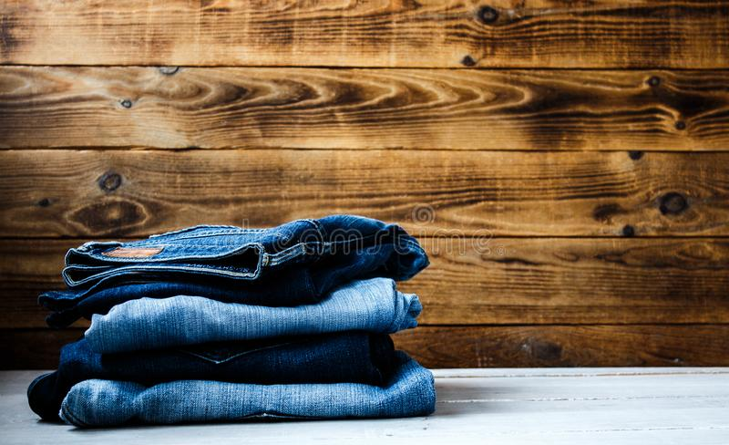 Jeans on a wooden background stock photo