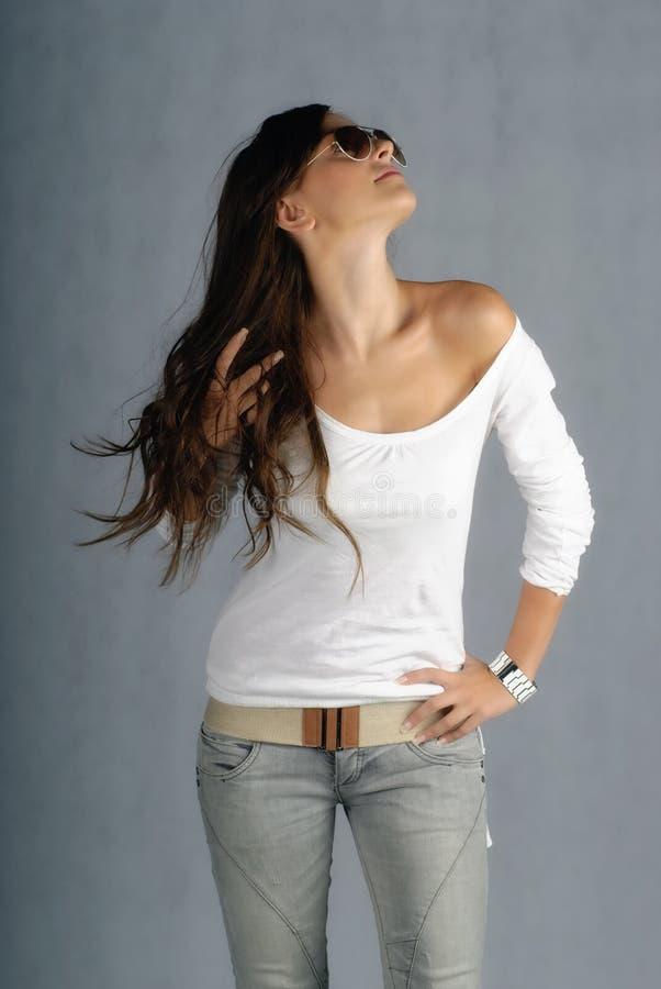 jeanskvinnabarn arkivfoto