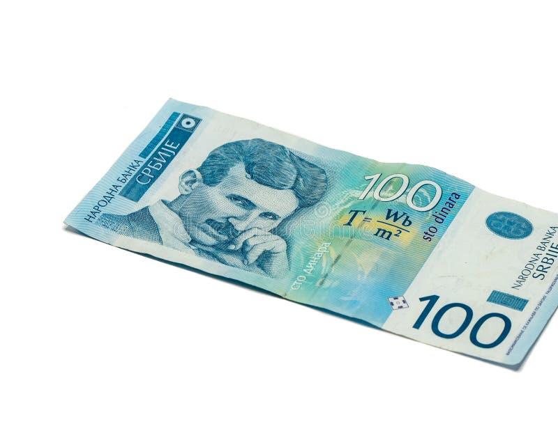 Jeden banknot warty 100 Serbskich dinarów z portretem naukowiec Nikola Tesla odizolowywająca na białym tle nowator i zdjęcia stock