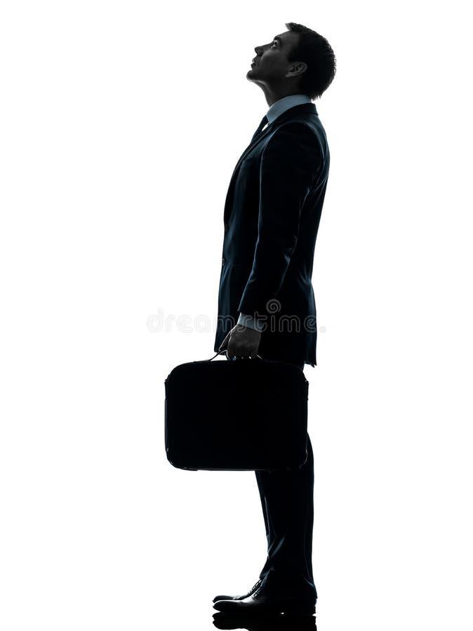 Biznesowy mężczyzna stoi przyglądającą up sylwetkę zdjęcie royalty free