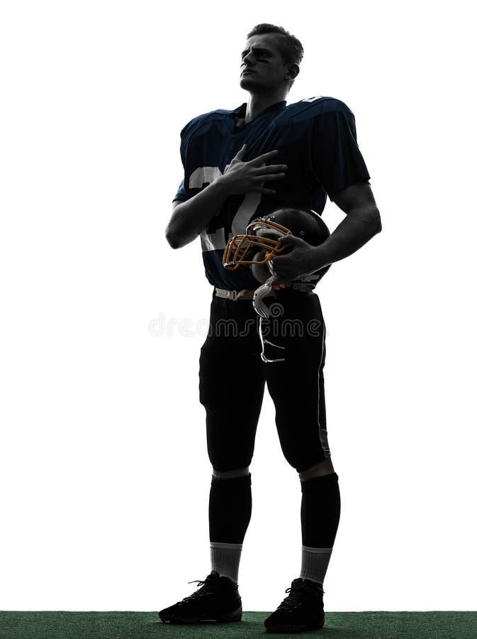 Futbol amerykański gracza mężczyzna ręka na kierowej sylwetce zdjęcia royalty free