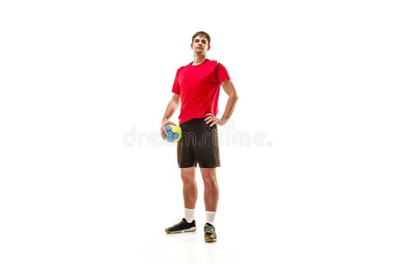 Jeden caucasian młody człowiek jako handball gracz przy studiiem na białym tle zdjęcia stock