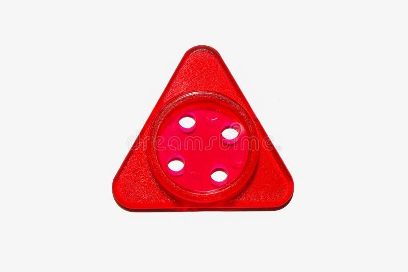 Jeden czerwony szwalny zabawkarski guzika trójboka kształt zdjęcia royalty free