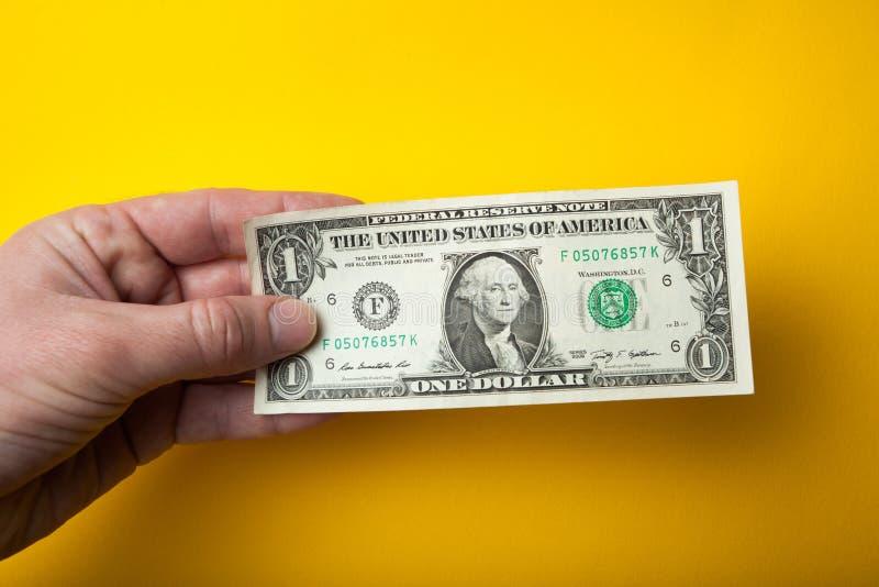 Jeden dolar w ręce, ubóstwo, pojęcie fotografia stock