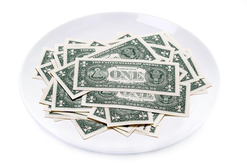 Jeden dolarowi rachunki na talerzu odizolowywającym obrazy stock