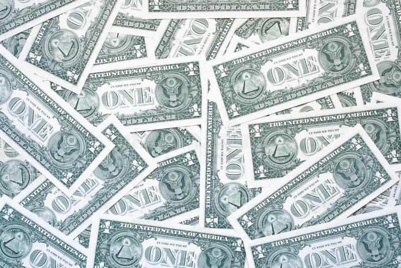 Jeden dolarowi rachunki od tylnego, prostego tła jeden dolar, obrazy stock