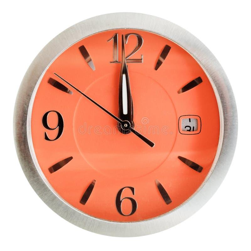 Jeden minuta dwanaście godzin na pomarańczowej tarczy zdjęcie stock