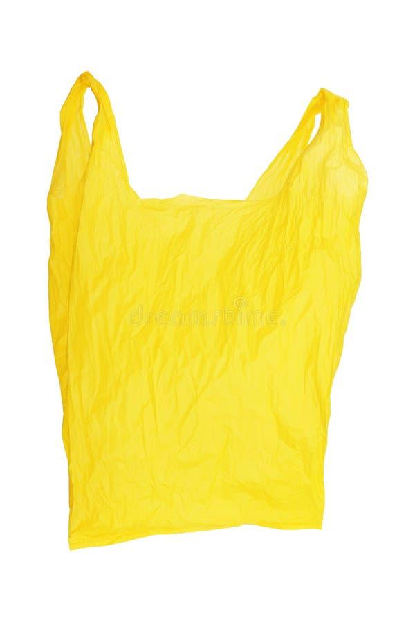 jeden otwarty marszczący żółty plastikowy worek odizolowywający na bielu zdjęcie royalty free