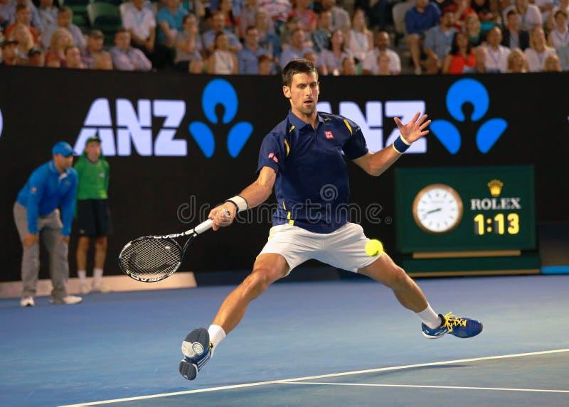 Jedenaście czasów wielkiego szlema mistrz Novak Djokovic Serbia w akci podczas jego australianu open ćwierćfinału 2016 dopasowani fotografia royalty free