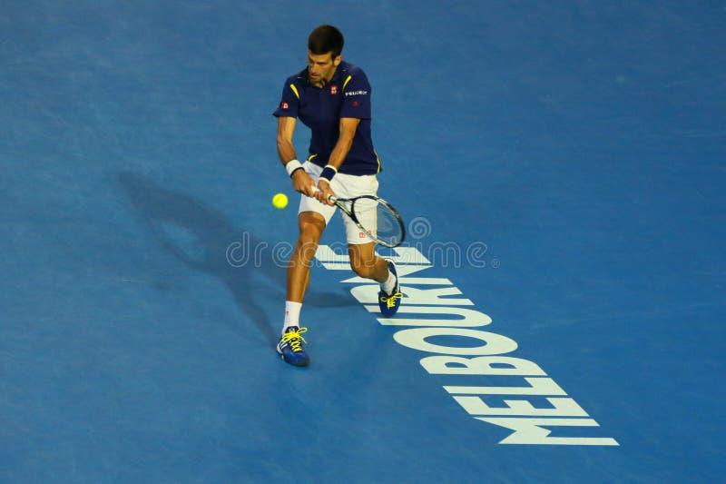 Jedenaście czasów wielkiego szlema mistrz Novak Djokovic Serbia w akci podczas jego australianu open 2016 definitywnych dopasowań zdjęcie stock