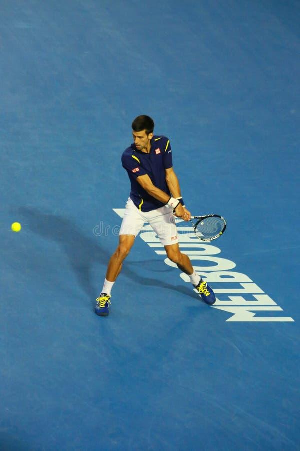 Jedenaście czasów wielkiego szlema mistrz Novak Djokovic Serbia w akci podczas jego australianu open 2016 definitywnych dopasowań obrazy royalty free