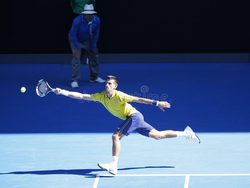 Jedenaście czasów wielkiego szlema mistrz Novak Djokovic Serbia w akci podczas jego round 4 dopasowania przy australianem open 20 zdjęcia stock