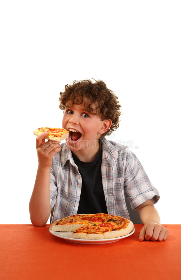jedząc pizzę chłopcze zdjęcia stock