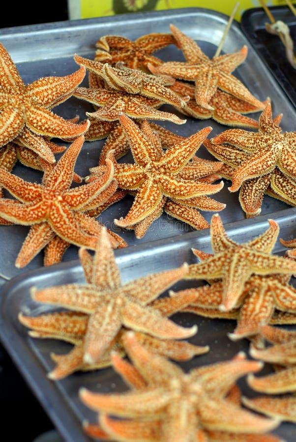 jedzenie chinom rynku gwiazdy morskie zdjęcie stock
