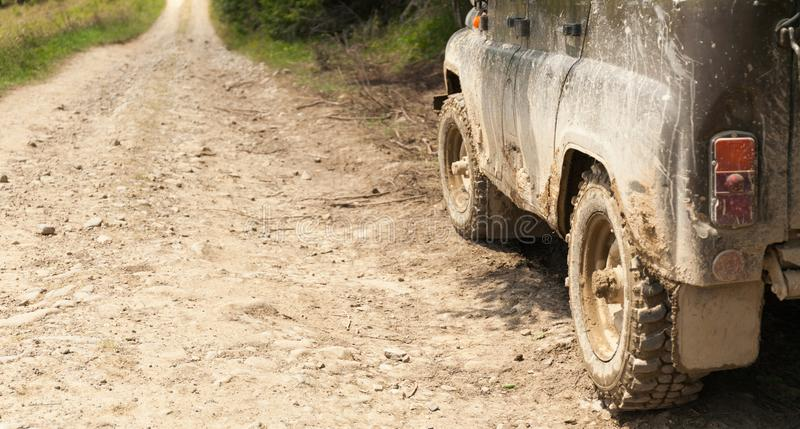 Jeep car 4Ñ…4 adventure travel. Old mountain dust road. Safari adventure. Copy space for text royalty free stock photo