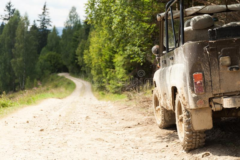 Jeep car 4Ñ…4 adventure travel. Old mountain dust road. Safari adventure. Copy space for text.  royalty free stock photos