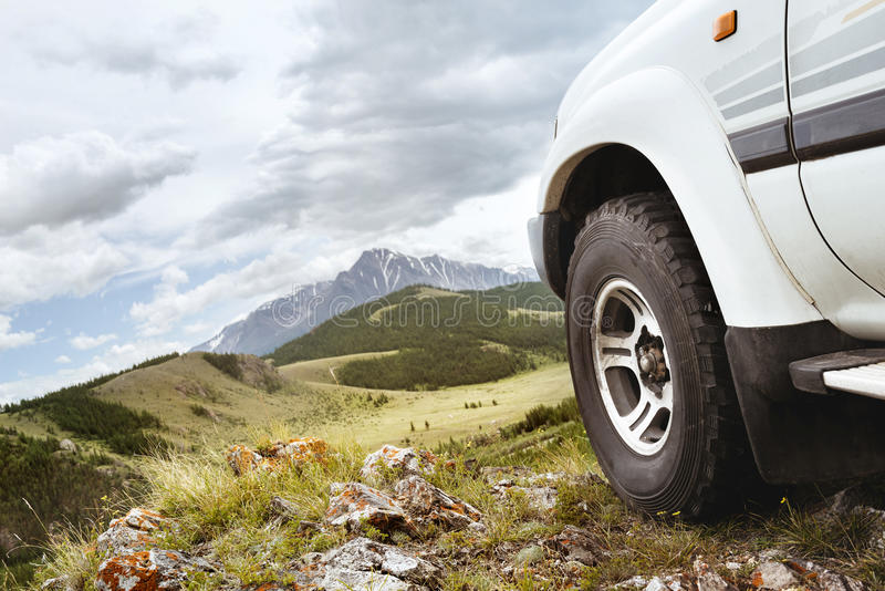 Jeep car wheel hill mountains stock photography