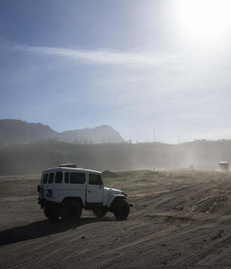 Jeep at the Desert with Sunlight stock photos