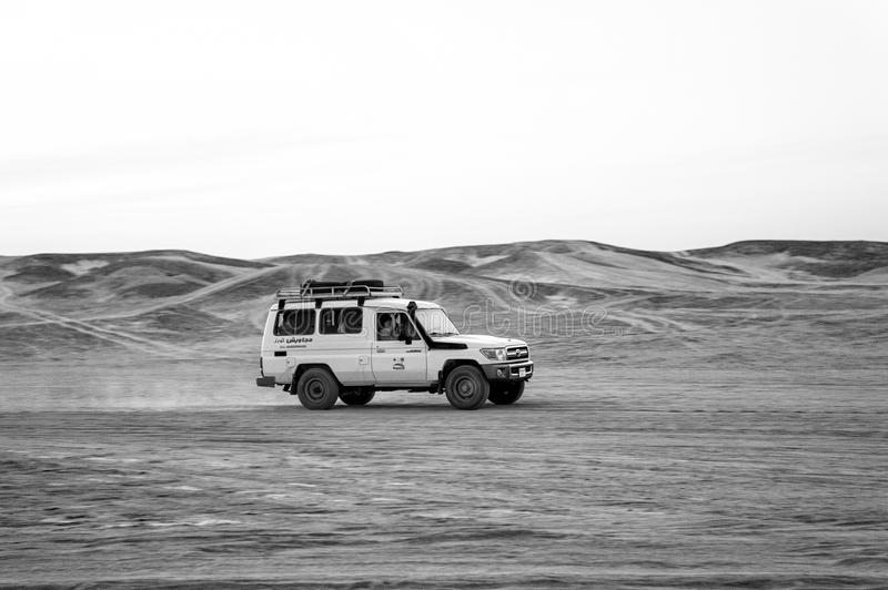 Jeep driving in sand dunes in desert, Hurghada, Egypt royalty free stock photo
