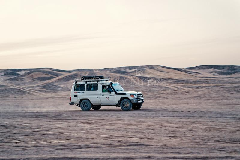 Jeep driving in sand dunes in desert, Hurghada, Egypt royalty free stock photography