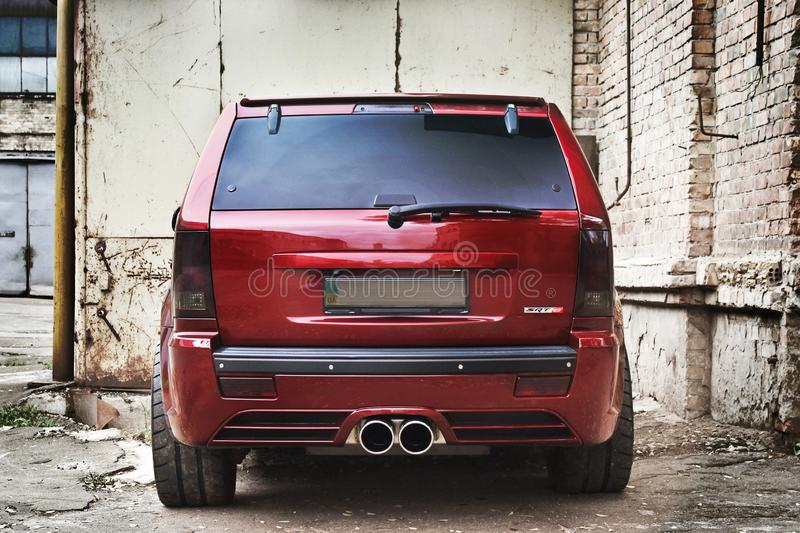 September 18, 2012, Kyiv. Ukraine. Jeep Grand Cherokee SRT8. Brutal off-road car on a background of ruins of buildings royalty free stock image