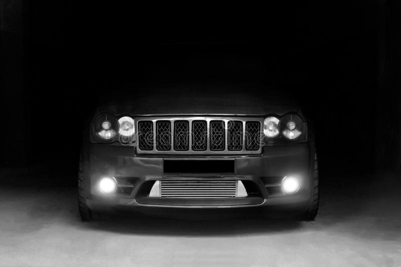January 3, 2011. Kharkov, Ukraine. Jeep Grand Cherokee SRT8 in the shadows with glowing lights in low light. stock image