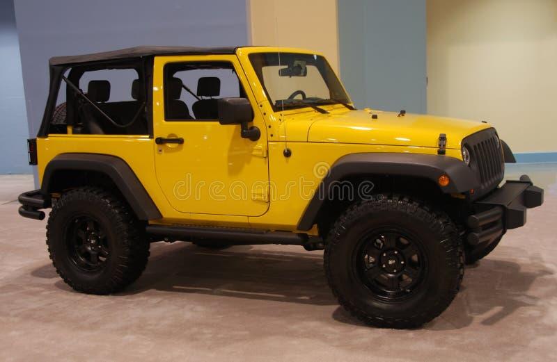 Jeep jaune photographie stock libre de droits