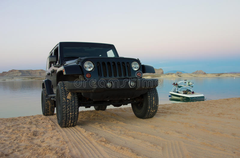 A jeep parked at a reservoir in utah. A vehicle parking at a campground on scenic lake powell in the desert royalty free stock photos