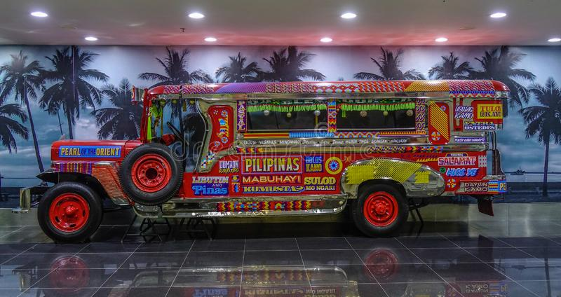 Jeepney for display in Manila Airport stock image