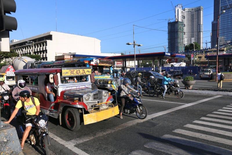 Jeepney, Manila. MANILA, PHILIPPINES - NOVEMBER 28, 2017: People drive in heavy traffic in Makati City, Metro Manila, Philippines. Metro Manila is one of the stock photography