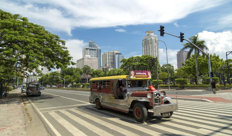 Jeepney on a road of Manila. Philippines, blue sky stock photo
