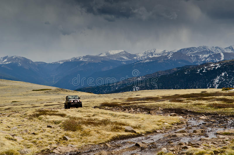 Jeeps driving on muddy surface royalty free stock photography
