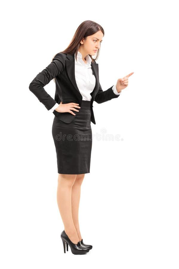 Jefe femenino enojado que amenaza con el finger fotos de archivo