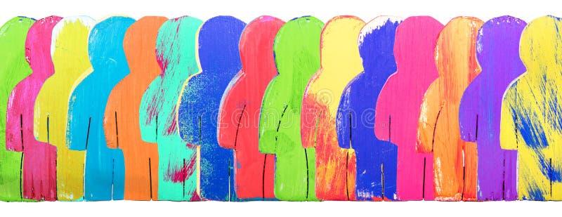 Jefe, figuras de madera coloridas en una línea, comunidad del concepto y foto de archivo libre de regalías