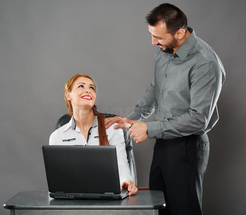 Jefe y empleado felices foto de archivo libre de regalías