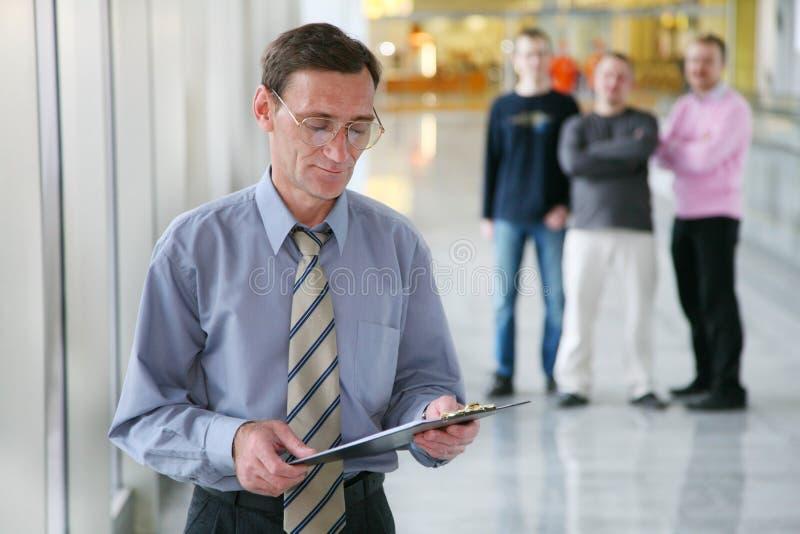 Jefe y trabajadores fotografía de archivo libre de regalías