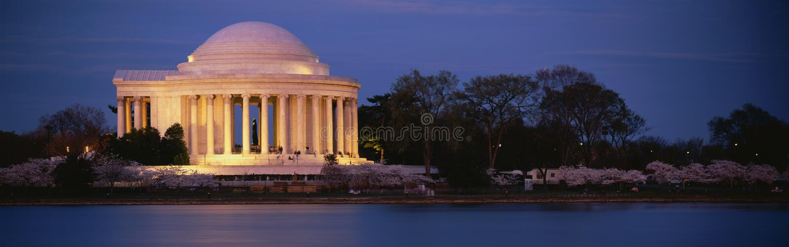 Jefferson Memorial at dusk. This is the Jefferson Memorial next to the Tidal Basin. Cherry blossoms are blooming on the trees surrounding it at dusk royalty free stock photography