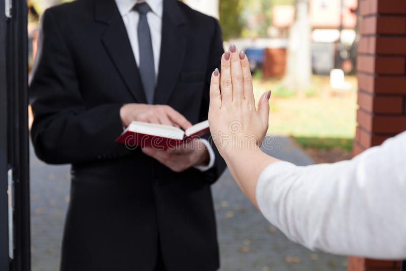 Jehovah's witness wants to evangelize. And refusing woman royalty free stock photos
