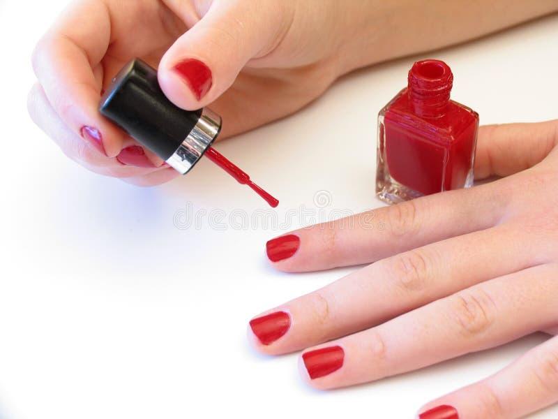 Download Jej malowanie paznokci zdjęcie stock. Obraz złożonej z palec - 43370