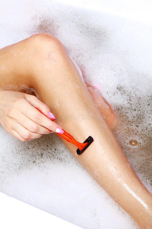 jej nogi golenia kobieta zdjęcie stock
