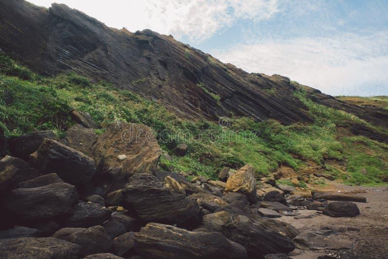 JEJU-INSEL, KOREA: Überraschende Klippe an Geommeolle-Strand, Udo Island Cow Island lizenzfreie stockfotografie